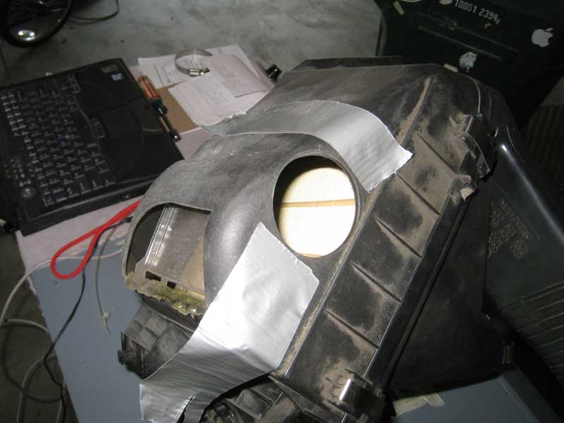 Modified airbox with baffle and one hole