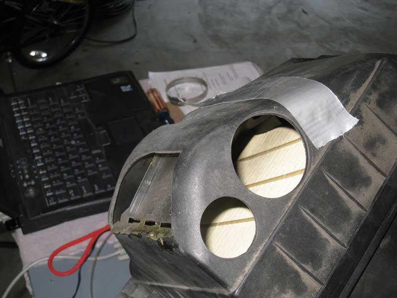 Modified airbox with baffle and two holes