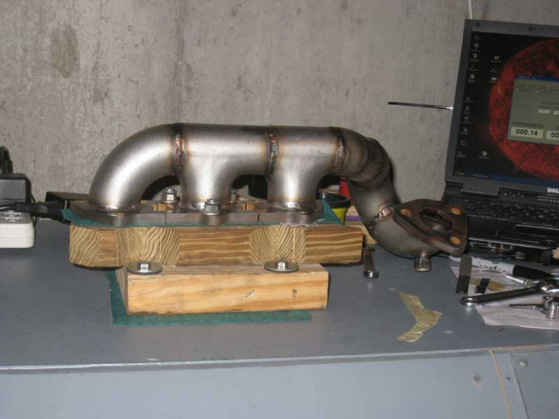 silly rabbit motorsport exhaust manifold mounted on flowbench