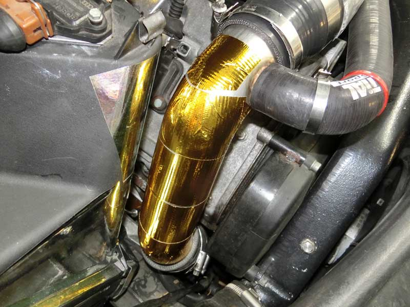DEI Reflect-A-Gold tape wrapped TiAL inlet pipe